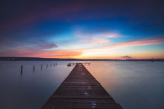 Beautiful cloudscape over the lake and blured boat Stock Photography