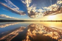 Beautiful cloudscape over the lake stock photo
