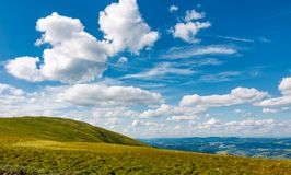 Beautiful cloudscape over the mountain meadow Stock Photos