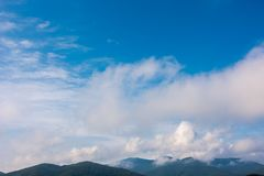 Beautiful cloudscape over the mountains. Lovely nature background Stock Photos