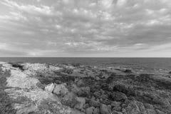 Coastline Mediterranean Sea in italy - monochrome. Beautiful cloudscape over the sea, rock sea Stock Photo