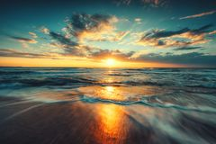Beautiful sunrise over the sea. Beautiful cloudscape over the sea, sunrise shot Stock Photo