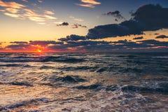 Beautiful cloudscape over the sea on sunrise Stock Photo