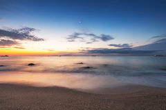 Beautiful cloudscape over the sea at sunrise Stock Photo