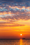 Beautiful cloudscape over the sea, sunrise shot Stock Photos
