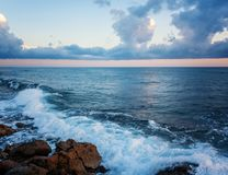 Beautiful cloudscape over the sea, sunrise and sunset shot stock photo