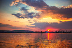 Beautiful cloudscape over the sea, sunset shot Stock Photos