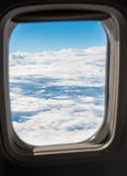 Beautiful Cloudscape from a Plane Window Royalty Free Stock Photo