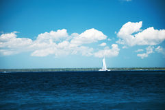Beautiful cloudscape and sailing catamaran in the carribean sea Stock Photos
