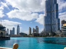 Beautiful cloudy day and blue sky outside Dubai Mall with an epic view of Burj Khalifa.  Royalty Free Stock Photos