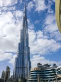 Beautiful cloudy day and blue sky outside Dubai Mall with an epic view of Burj Khalifa. UAE Royalty Free Stock Image