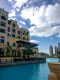 Beautiful cloudy day and blue sky outside Souk Al Bahar next to Dubai Mall fountain.  Stock Image