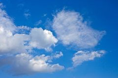 Beautiful cloudy deep blue sky. A beautiful deep blue sky with some white clouds royalty free stock image