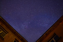 Beautiful cloudy night sky near the building Stock Images