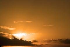 Beautiful cloudy orange sunset sky in the wild Atlantic way Stock Photos