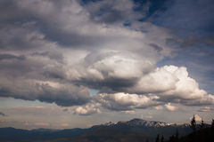 Beautiful cloudy sky in Carpatian Mountains. Dragobrat Stock Photos
