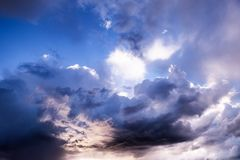 Beautiful cloudy sky with glimpses of the sun. Sunset sun with clouds in the sky stock images
