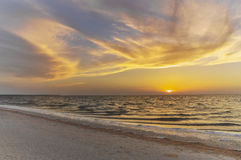 Beautiful cloudy sky over a calm sea, dawn.  Royalty Free Stock Photos