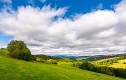 Beautiful cloudy sky over the forested hills. Wonderful nature of Carpathians in early autumn Stock Photo