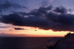Beautiful cloudy sky over sea at sunset. Portuguese island of Madeira stock image
