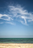 Beautiful cloudy sky over white sandy beach. Vertical photo background Royalty Free Stock Photography
