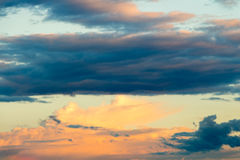 Beautiful cloudy sky with sun rays. Cloudy abstract background. Sunset light. Royalty Free Stock Images