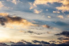Beautiful cloudy sky at sunset. Abstract cloud formations colored in to gold by sunlight from below. lovely nature background Royalty Free Stock Photography