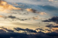 Beautiful cloudy sky at sunset. Abstract cloud formations colored in to gold by sunlight from below. lovely nature background Royalty Free Stock Photos