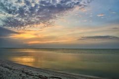 Beautiful cloudy sunrise at sea landscape Royalty Free Stock Photos
