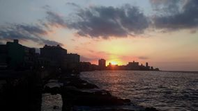 Time lapse during sunset in Malecon, Havana. Beautiful cloudy sunset in Malecon, Havana stock video footage