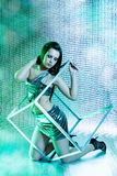 Beautiful club girl with metal cube Stock Photos