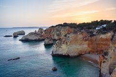 Beautiful coast of Algarve at sunset, Portugal royalty free stock images
