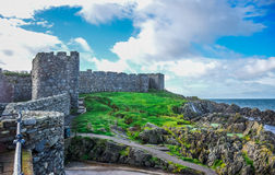 Beautiful coast of the Isle of Man from Peel Hill with great wall of Peel Castle in Peel, Isle of Man Stock Images
