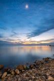 Beautiful coast sea with the moon at twilight Royalty Free Stock Photo