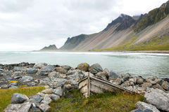 Beautiful coast Stokksnes with old boat. View to the Atlantic ocean, Iceland Stock Images