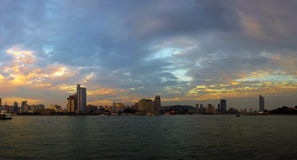 Beautiful coastal city at dusk Stock Photos