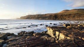 Beautiful coastal landscape at sunrise with cliffs Stock Photo