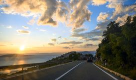 Beautiful coastal road at sunset Royalty Free Stock Photos