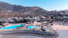 Beautiful coastline and cityscape of Airlie Beach, Queensland. A. Erial view from drone royalty free stock image