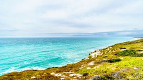 The beautiful Coastline of False Bay along Baden Powell Drive between Macassar and Muizenberg near Cape Town. South Africa Stock Photos