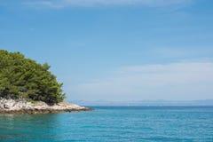Beautiful coastline with green forest, stones and blue sky and sea water. Natural wallpaper. Adriatic coastline. Croatia. Mediterranean sea stock photos