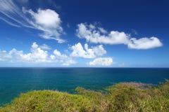 Beautiful coastline of Saint Kitts. Wispy clouds form off the coast on the Caribbean island of Saint Kitts Stock Images