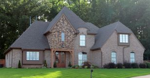 Beautiful Cobblestone and Brown Brick Suburban Home Stock Photo