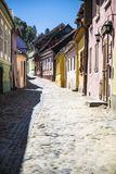 Beautiful cobblestone street  in Romania in vertical format. Beautiful cobblestone street  in  Sighisoara Romania in vertical picture royalty free stock photo