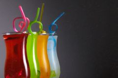 Colorful coctails with straw, summer royalty free stock image