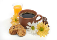 A beautiful coffee scene. A beautiful coffee breakfast with cookies, orange juice, coffee beans and flowers.  Look at my gallery for more delicious meals Stock Photos