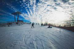 Beautiful cold mountain view of ski resort, sunny winter day with slope Royalty Free Stock Photo