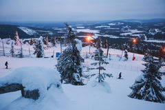 Beautiful cold mountain view of ski resort, sunny winter day with slope. Piste and ski lift, Lapland, blue sky stock photos