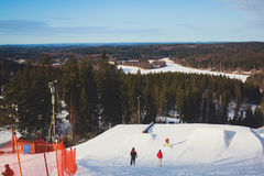 Beautiful cold mountain view of ski resort, sunny winter day with slope Stock Photography