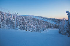 Beautiful cold mountain view of ski resort, sunny winter day wit Stock Photos